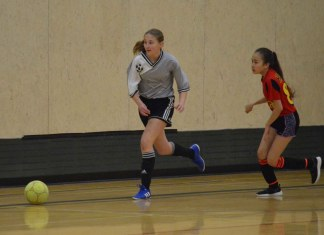 Keira Coakwell, left, of the Stittsville Hay River girls' team chases the ball during the Junior Super Soccer tournament in Yellowknife. The team finished second in its division. James McCarthy/NNSL photo