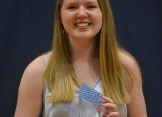 Emma Willoughby received the Lanky Muyres Award, which honours the top scholastic student at Sir John Franklin High School, during the school's Athletic Hall of Fame ceremony on May 24. James McCarthy/NNSL photo