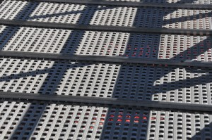 Walkway made of metal with holes and raised slats