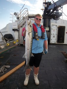 Drew, Scientist, holding a barracuda