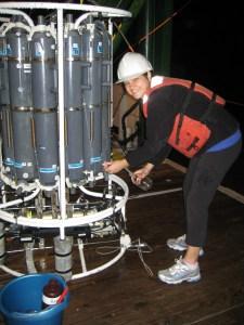 Liz takes a water sample