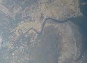 View out the window of the plane to Petersburg of a meandering river