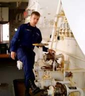 Ensign Nick Custer shows us where the ship is refueled. Can you imagine pumping a million gallons of fuel!!!