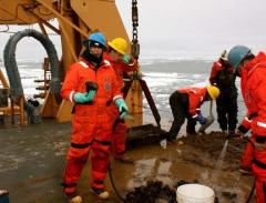 Dredge #2 was a muddy affair.  Using the hose, I helped separate the sediment from the rocks.  That's me in the turquoise gloves!