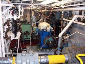 The engine room is a busy, confusing, and crowded place, but the engineers know how to maintain every one of the machines.