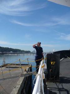 Ensign Heather Moe coming aboard the Miller Freeman in Port Angeles, Washington