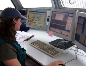 Erin Campbell operating the C3D sonar aboard the launch.