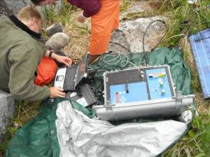 The tide gauge interface being downloaded to a weather/shockproof laptop computer