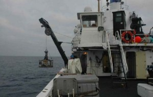 The CTD being lowered from the J Frame on the NOAA ship DAVID STARR JORDAN