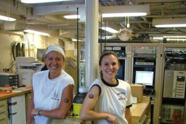 Junior Officer Phoebe Woodward and TAS Karolyn Braun show off their ARGO tattoos by the ARGO floats before deployment.