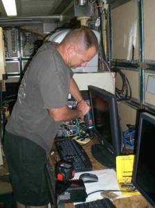 Research Fisheries Biologist Dr. Mike Jech securing computer equipment to prepare for sailing on board the DELAWARE II.