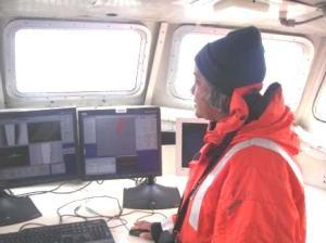 TAS Jacquelyn Hams viewing sonar images on a survey boat