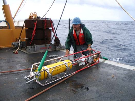 Jeff attaching a current meter (Invented and patented by Dr. Weller) to the bottom of the buoy.  It weights about 160lb and there are eight of them.  Please note the safety equipment Jeff is wearing.  SAFETY FIRST!