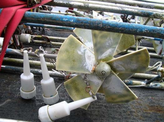 Damage to a current meter caused by fisherman's gear.  Of the 8 meters, 6 were fouled. Here we have entanglement of the current metering fans by fishermen's lights. They use these lights on their lines to attract fish to their hooks at night.  Once the entanglement occurs data cannot continue to be gathered.