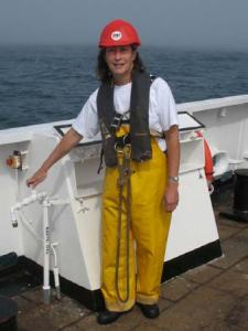 Amy Pearson with a harnass connecting with ship for buoy deployment.