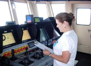 NOAA Teacher at Sea Miriam Hlawatsch recording weather data on the Bridge of the NANCY FOSTER.