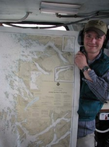 Survey Tech Boles holds a Navigational Chart developed by NOAA that also includes Hydrographic survey data