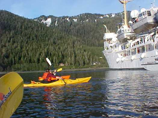 Kayaking excursion enjoyed after hours by some of RAINIER'S crew.  In photo are the XO, Julia Neander and AB Leslie Abramson.  Photo was taken by TAS Jeff Lawrence on the evening of May 24th in the Wrangell Narrows off the Alaskan coastline.