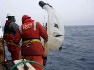 Crewmembers deploy bongo nets.