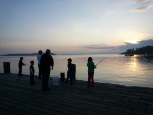 Sunset and fishing on Chandlers Cove Wharf, Chebeague Island, Maine