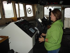I even felt safe when they let me man the helm (steer the ship).  Out of picture, Officer LTJG Adam Pfundt and Able Seaman Robert Steele guide me through my first adventure at the helm!