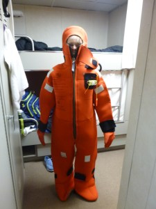 Janelle Wilson wears immersion  suit for abandon ship drill.