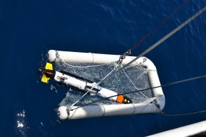 AUV being lowered into the blue