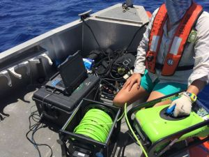 ROV being set up for deployment.  Note the spool of tether cable and control panel.