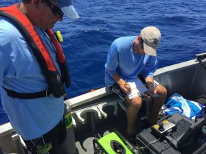Jeff from FWC records the coordinates before beginning ROV survey