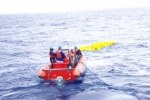 The RHIB heads out to retrieve 80 air-filled glass balls that were attached to the mooring's anchor.