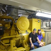Here, Dana Reid and I take a break at the generator that produces AC electricty.