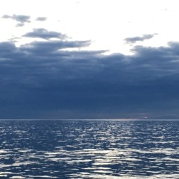 Grey sky and shimmering seas