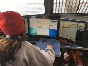 Hydrographer Megan analyzing the data