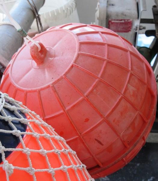 Orange plastic buoy used in longline fishing