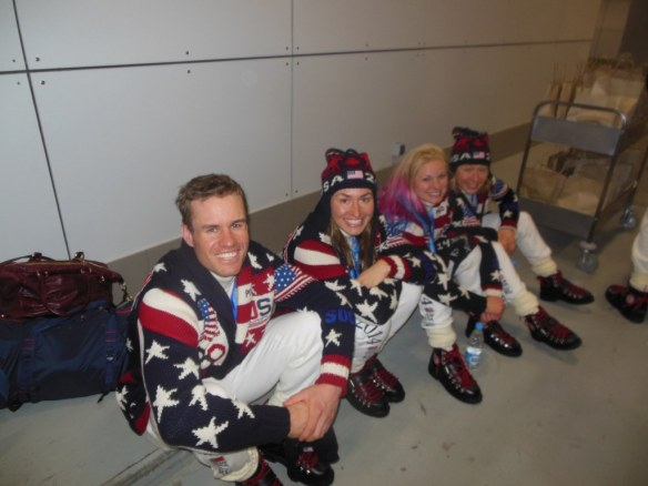 US Cross Country Team Sitting on Concrete