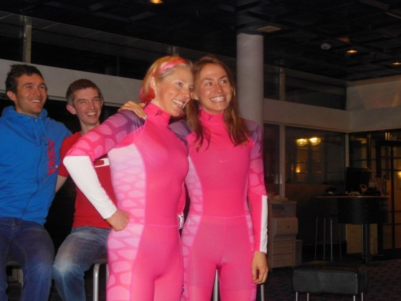 Kikkan Randall and Sophie Caldwell in Pink Race Suits