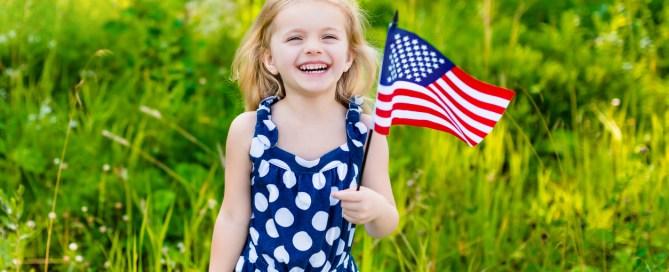 little girl waving flag