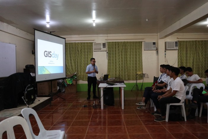 June Reyes, Nobel Systems Project Manager gives a presentation on GIS to Ormoc National High School Students in the Philippines during GIS Day activities.