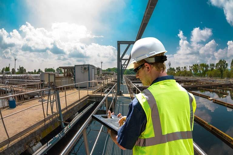 Water utility management software man with tablet