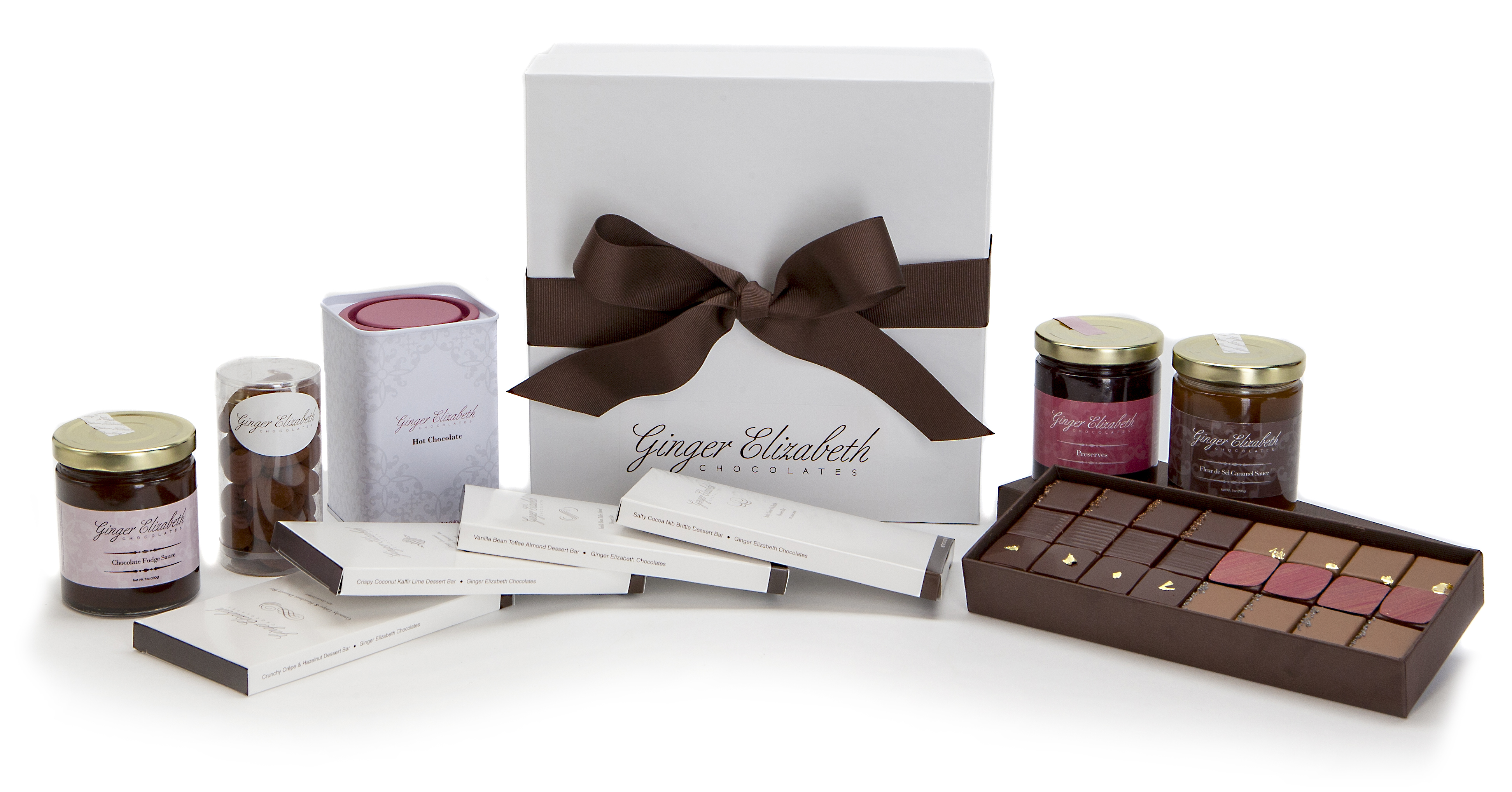 Sugar sweet. Who can resist a hat box filled with delicious chocolate goodies?; $155, gingerelizabeth.com.