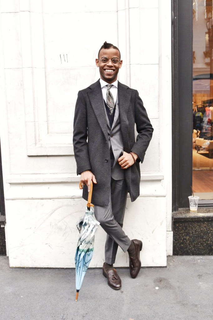 """Michael Wayne Turner III (Instagram: @sir_michaelwayne) is an associate for Knot Standard, a custom menswear retailer nestled in Jackson Square. His style is bold, classic and, as he puts it """"a kick in the mouth. I love the creative flair and flamboyance of color and aggressive tailoring."""" Suit: Gray/navy 120s suit with a sharkskin take"""