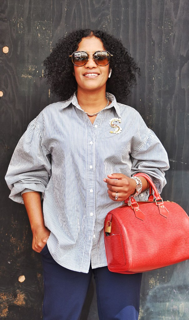 """Hawo Abdi of San Francisco caught our eye with her crisp puff-sleeved shirt, bold bag and vintage brooch. """"I like my look comfortable and not too tight. An everyday style — and classy looking!' Top: Levi's; Pants: Lululemon; Bag: Louis Vuitton"""