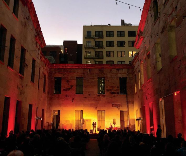 Author Matthew Clark Davison tells a personal tale in the courtyard of the Old Mint during last month's Porchlight series: The Bitch Is Back: Tales of Resurgence.
