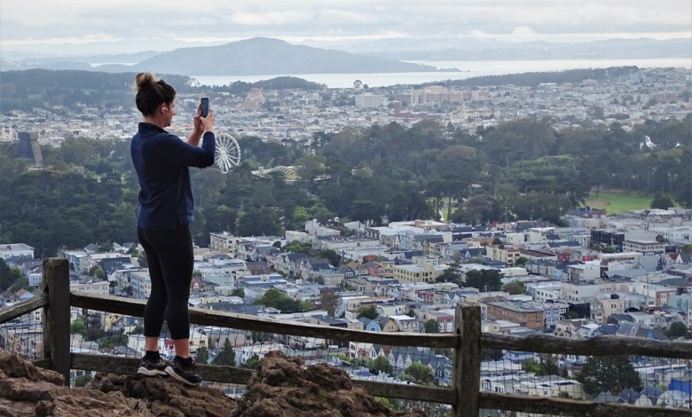 Runner Sarah Goodman pauses to take a photo from the summit of Grandview Park.