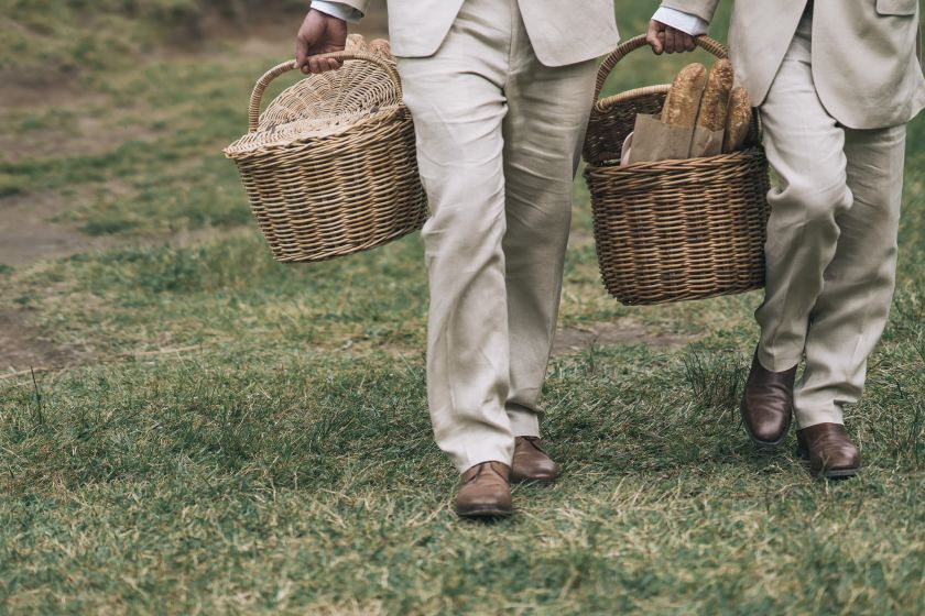 groomsmen carrying picnic baskets