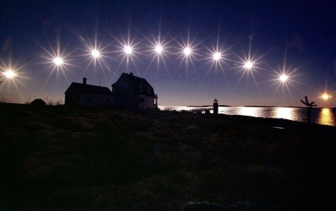 The sun, nearing winter solstice, travels low across the sky in a multiple-exposure picture made in Maine in 2002.