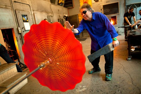 Seattle glass Artist Dale Chihuly puts the finishing touches on a piece of glass at his studio in Seattle on Wednesday, January 26, 2011. (CREDIT: Mike Kane for the Boston Globe)