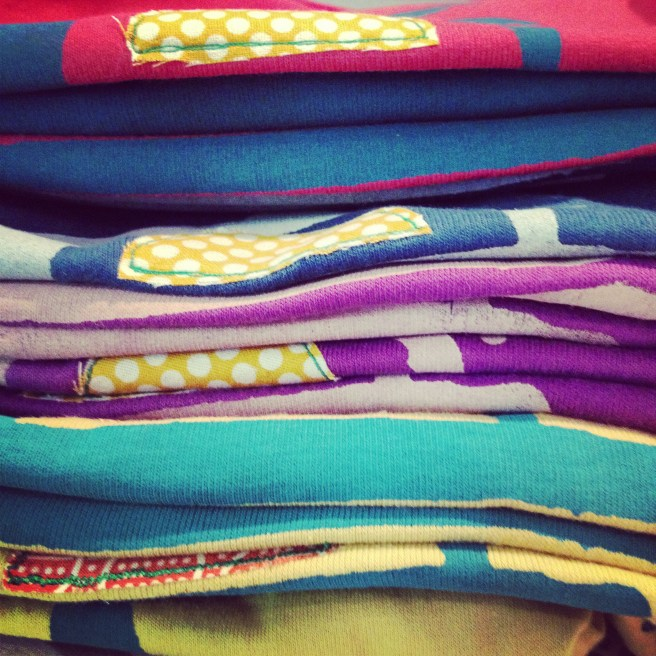 Stack of new onesies.