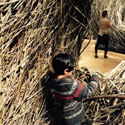 sulking 5 year old interacting with Patrick Dougherty's Shindig.