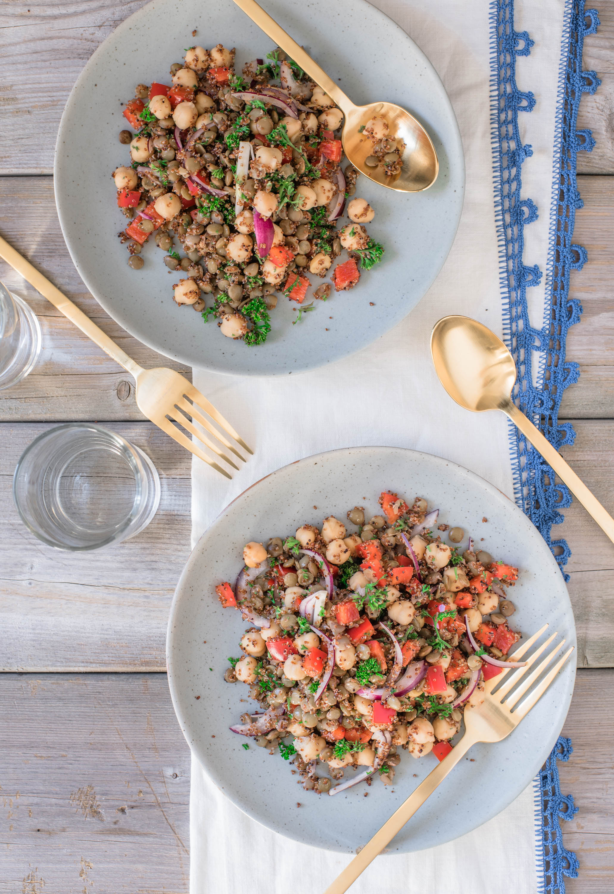 top down angle of two super healthy and quick 5 minute lentil chickpea salad plates